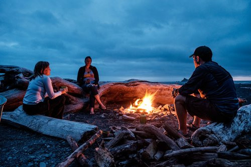 Sitting by the fire at our primitive campsite at Rialto Beach with our good friends from DC, The Mooks!