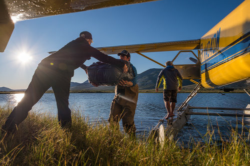 Our fearless guides from Alaska Alpine Adventures, Nick and Sean, shuffle gear from the float plane to our first camp on the Noatak River.