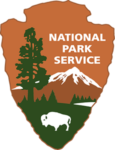 The iconic National Park Service 'Arrowhead' logo shows a sequoia tree and bison, representing vegetation and wildlife; mountains and water represent scenic and recreational values, and the arrowhead shape represents history and archeology.