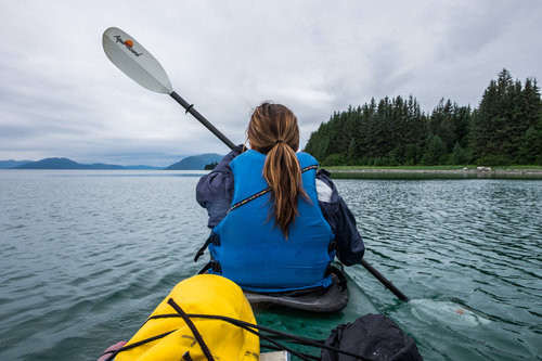 Stef paddles out into Bartlett Cove from the Glacier Bay Lodge.