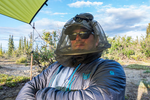 Jonathan looking fashionable in his mosquito resistant bee-keeping outfit. :)