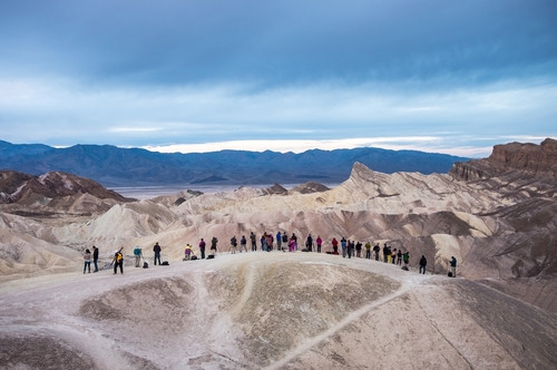 Sunrise photographers line up at Zabriskie Point; sunrise is usually a full house too.
