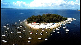 Beer can island in Tampa Bay surrounded by boats.