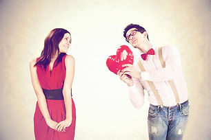 Funny Valentine's Day,romantic boy gives a heart to his girlfriend.jpg