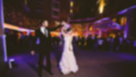 Bride and groom dancing at a wedding reception