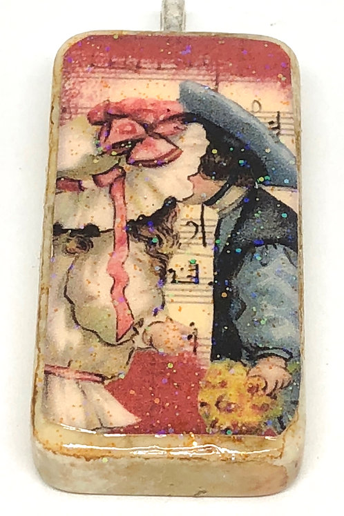 Pink Vintage Music Background with Boy Girl Kissing Altered Art Domino Pendant