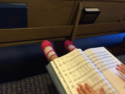 Lucy & hymnbook