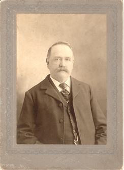 Mr. Charles E. Hoit first housed the library in the back of his store. He was also the first librarian in the current library building.