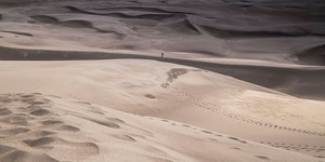 Lone walker on Sand Dunes _ Some people try to associate geometrical design with images captured.jpg