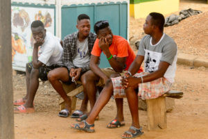 AFRICAN FICTION, WESTERN READERS: Young Ghanaian men having a discussion (Shutterstock/Anton Ivanof)