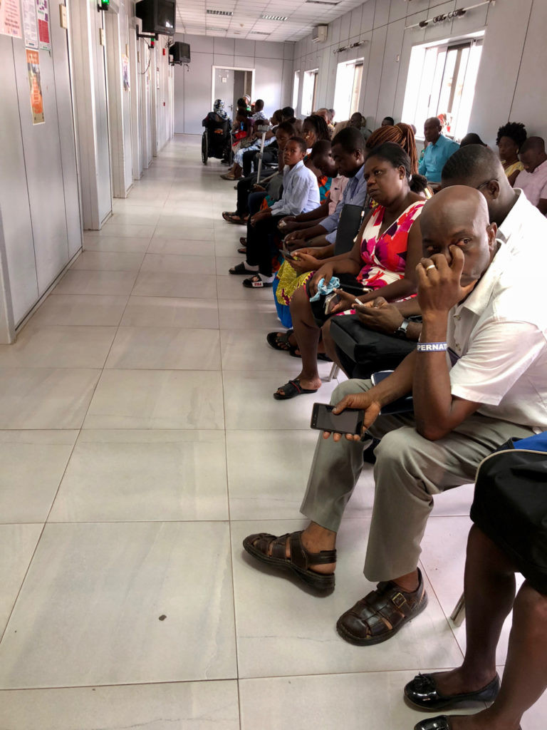 Patients patiently waiting (medicine in a West African country)