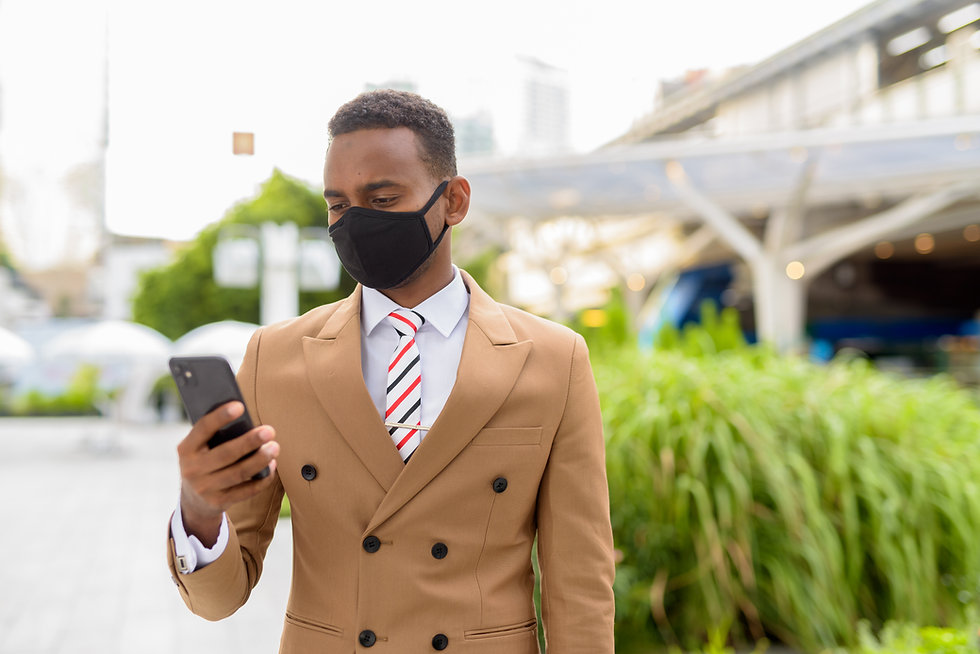 young-african-businessman-using-phone-wi
