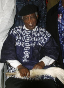 """Nigerian writer, 70, Chinua Achebe, who gave us a lesson in writing African fiction westerners, is pictured on January 19, 2009 during a welcoming ceremony at Nnamdi Azikiwe International Airport in Abuja upon his return to Nigeria for the firrst time in over 10 years. Achebe, whose most famous work is 1958's """"Things Fall Apart,"""" is a literature professor at Bard College in New York state. AFP PHOTO / Abayomi Adeshida (Photo credit should read ABAYOMI aDESHIDA/AFP via Getty Images)"""