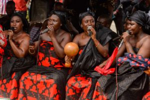 AFRICAN FICTION, WESTERN READERS: Funeral in Ghana, women in the traditional colors of black and red--both shoulders can be bare. (Photo: Anton _Ivanov / Shutterstock)