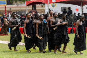 AFRICAN FICTION FOR WESTERN READERS: Funeral in Ghana, the men 's traditional cloth is thrown over one shoulder and the other is left exposed (Photo: Anton _Ivanov / Shutterstock)