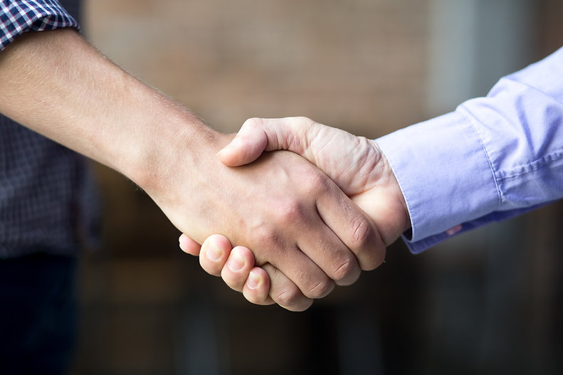 closeup-of-two-business-men-shaking-hand