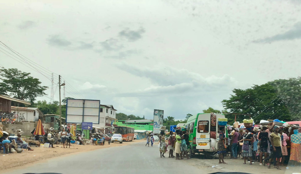 "Research you novel: ""enthusiastic"" vendors swarm a mini-bus (Photo: Kwei Quartey)"