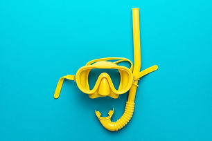 flat lay shot of yellow diving mask with