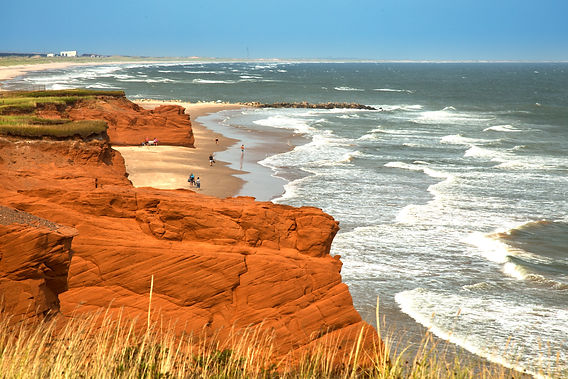 Red cliff in Havre aux maisons with wave