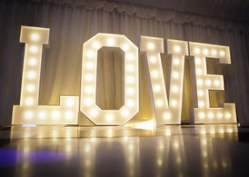 large ligt up love letters marquee wedding dancefloor