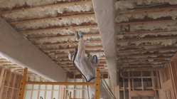 Crews Install Insulation in House
