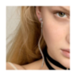 AC 2019 Onda Ring on Model Ear.jpg