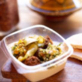 A hummus bowl with falafel and salad