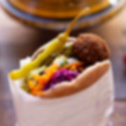 Pitta full of falafel and salad with a chilli