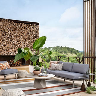 Outdoor, armless sofa, chair, rug and tables