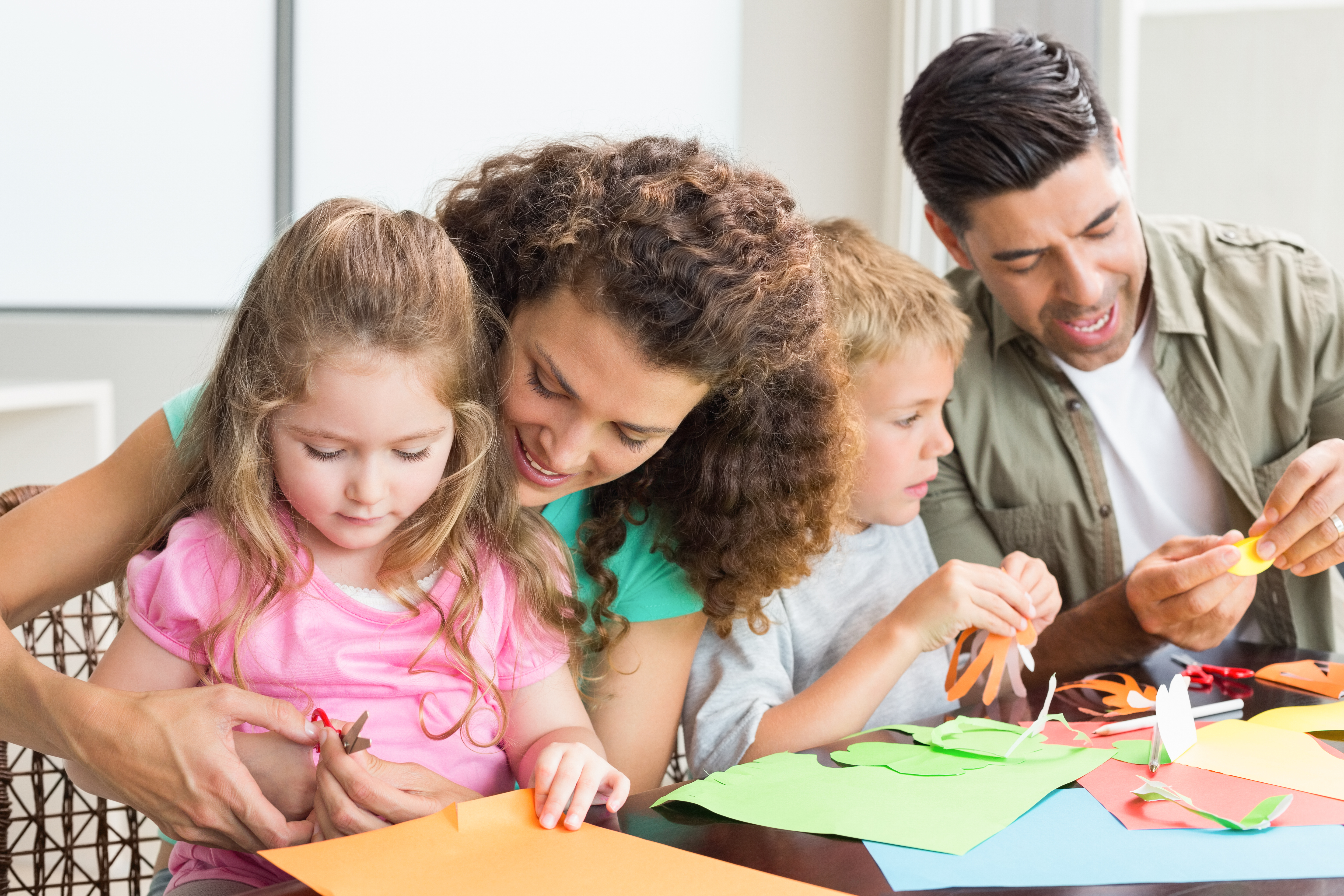 bigstock-Cheerful-family-doing-arts-and-60522305