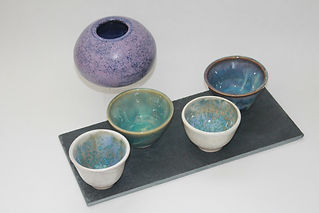 A selection of blue and mauve bowls