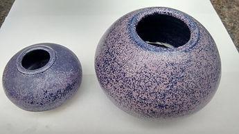 Two sizes of posy bowls glazed with 'Syringa'