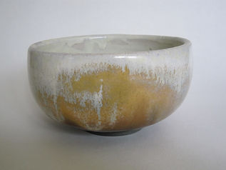 Deep bowl sprayed several times with layers of brown and white glaze