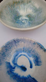 Close up detail of two bowls using a glaze which develops irregular crystals when fired