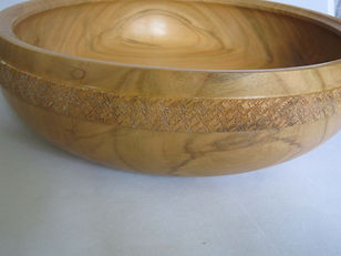 Fruit bowl made from Cherry wood with band of 'chattering' on the outside.