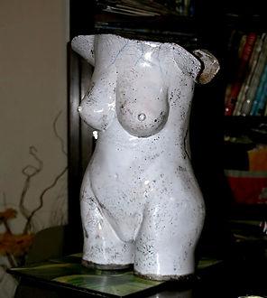 Hand built sculptured torso fired using the Raku method