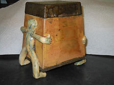 Square slap built lidded pot using lifting figures at each end as feet
