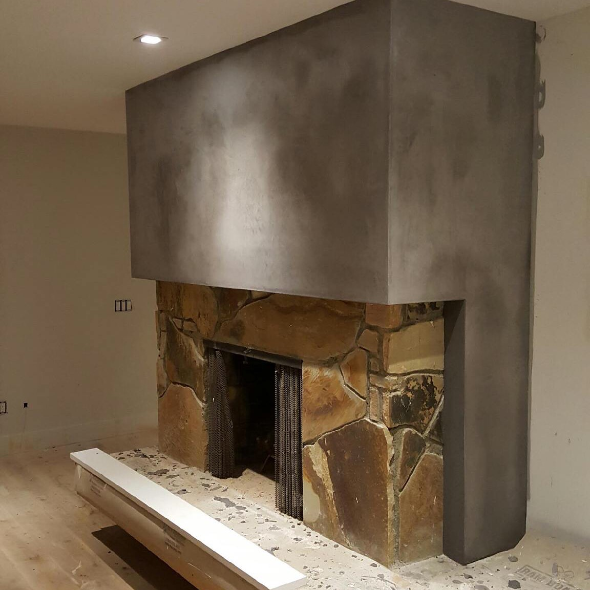 Concrete and stone fireplace