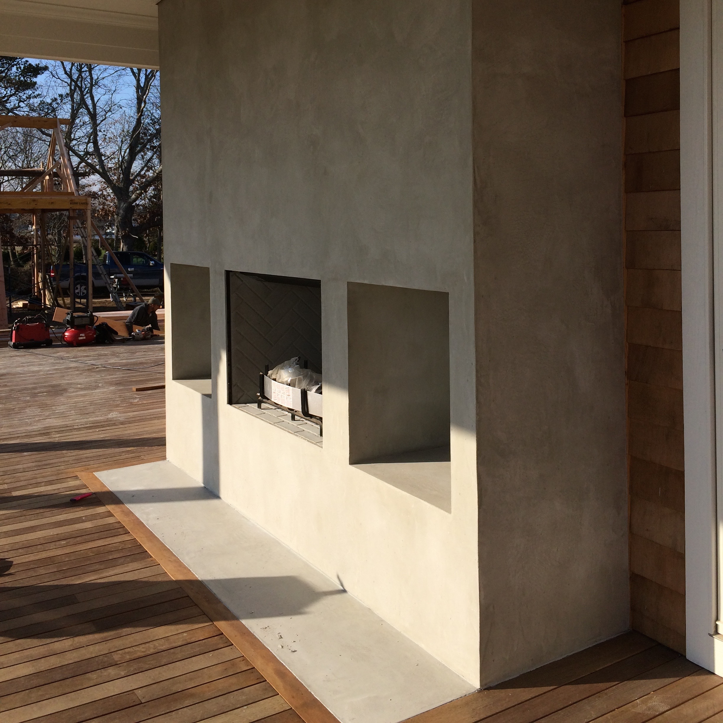 Outside fireplace in faux Concrete