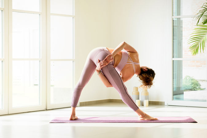 woman-doing-triangle-yoga-pose-indoors-R