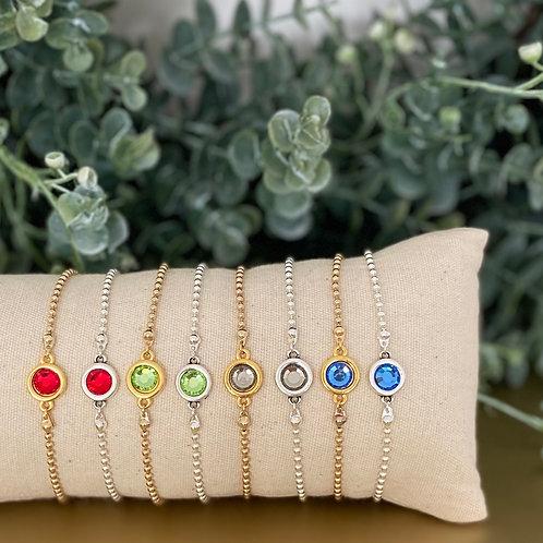 Verschillende ballchain armbandjes met gekleurd tussenzetsel
