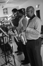 Corey A. Wallace on Trombone and Benny Russell on Tenor Saxophone