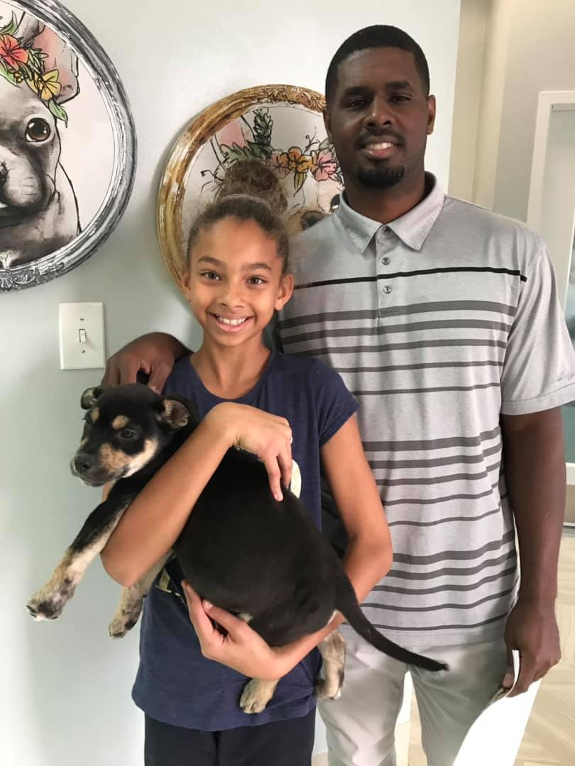 Father and daughter adopting a dog from Hope for Life