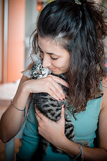 graphicstock-woman-hugging-cat-at-home_r