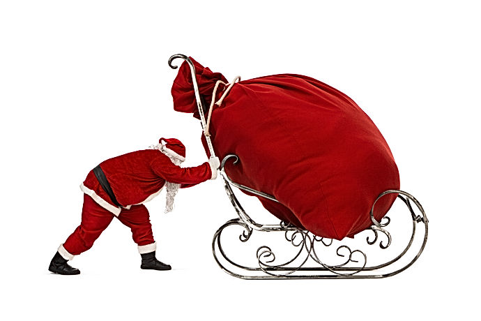 Santa Claus pushing sleigh with huge bag