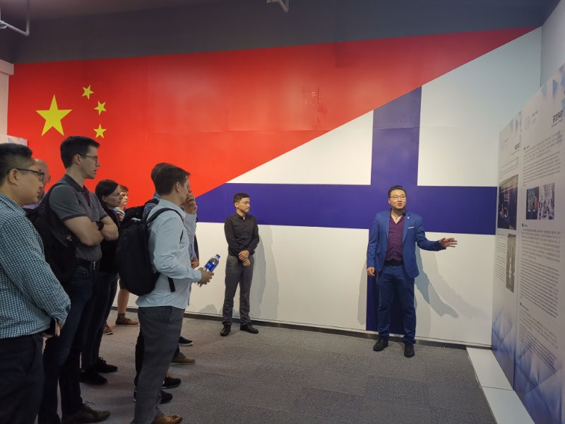 Tech Centre tour being given by FinC CEO William Zhu
