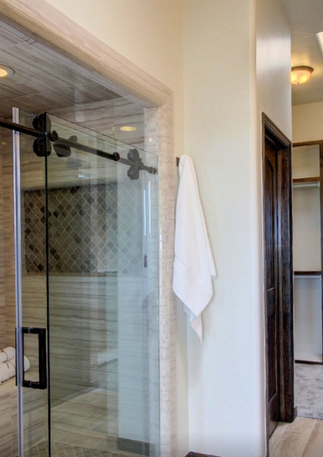 Large Walk-In Shower with Dual Temperature Contol Showerheads, Rainfall Shower Head, Sitting Bencg, and Nichos