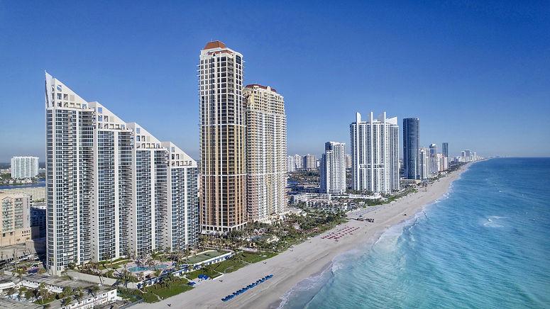 buildings-beaches-and-blue-sea-water.jpg