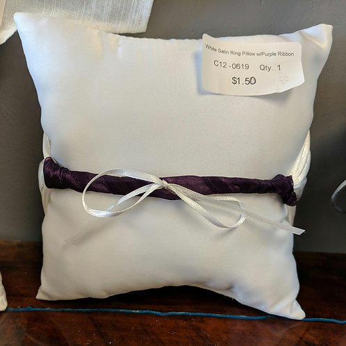 White Ring Pillow with Purple Ribbon