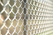 Close up Chain Fence. Metal mesh .  Whit
